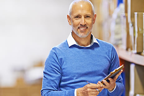 Man with tablet smiling